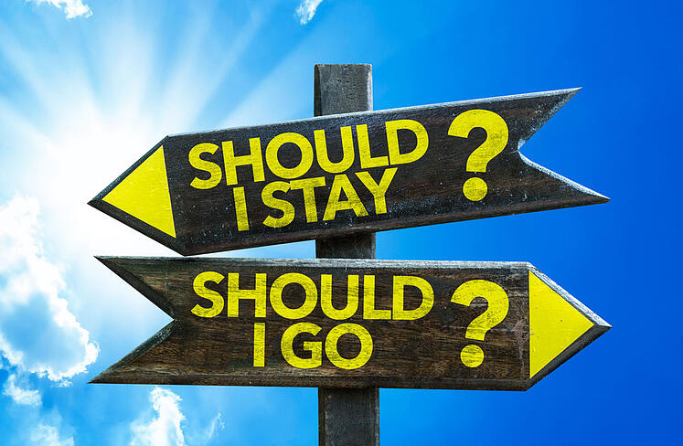 Should-I-Stay-Should-I-Go-signpost-with-sky-background