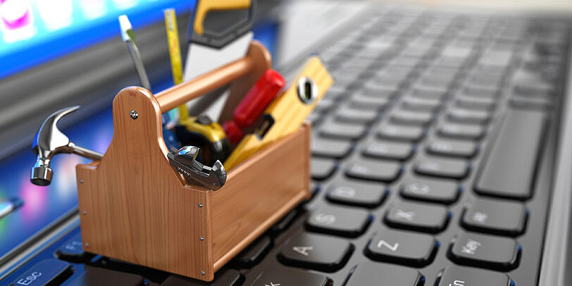 Tools on top of a computer keyboard