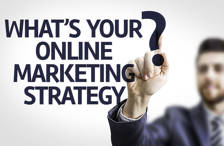 Business-man-pointing-to-transparent-board-with-text-Whats-your-Online-Marketing-Strategy