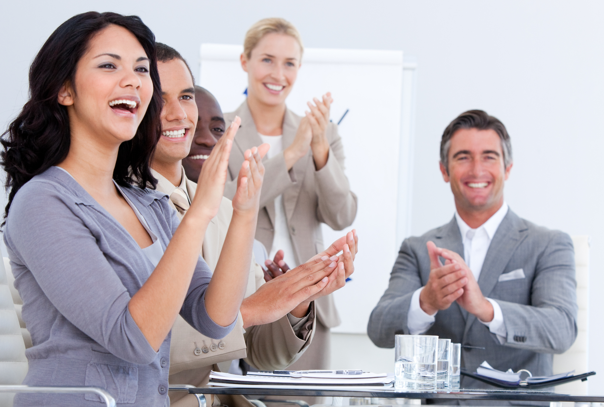 Cheerful business applauding in a meeting