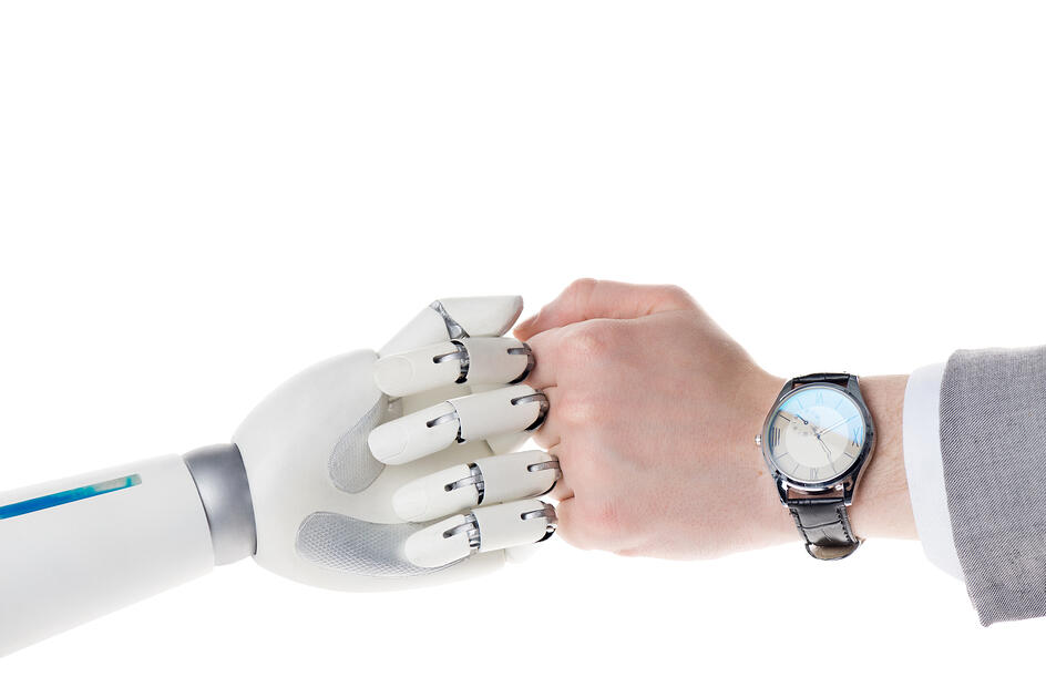 Cropped shot of robot and businessman