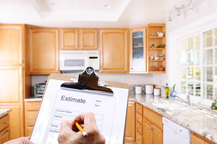 Contractor writing an estimate