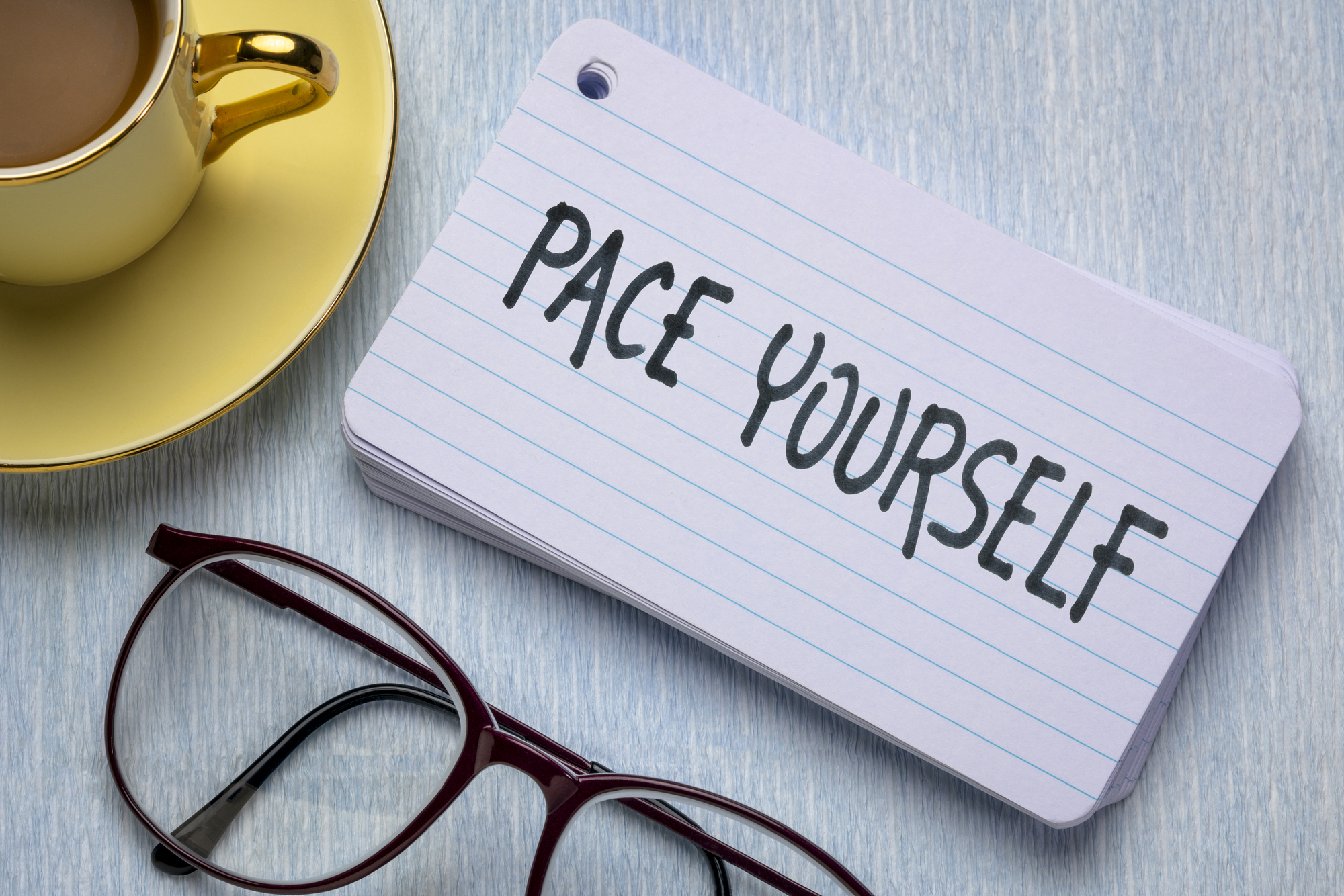 Pace yourself reminder - handwriting on index card with a cup of coffee, business and lifestyle