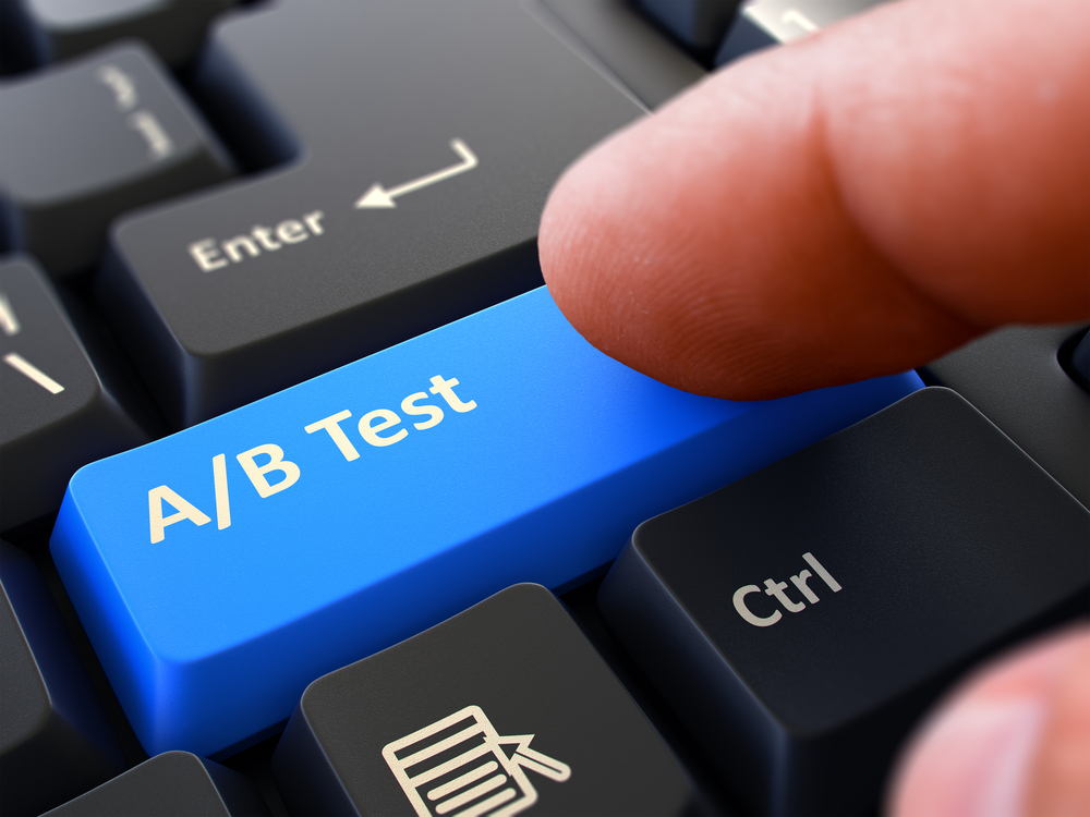 AB Test - Written on Blue Keyboard Key. Male Hand Presses Button on Black PC Keyboard. Closeup View. Blurred Background.-1