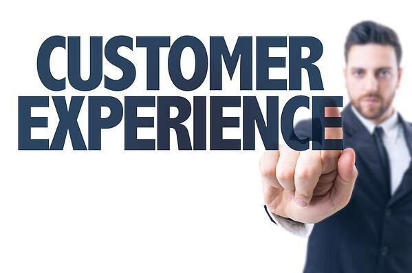 Business man pointing the text Customer Experience-1