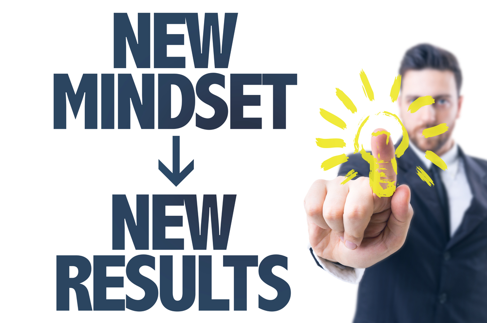 Business man pointing the text New Mindset New Results