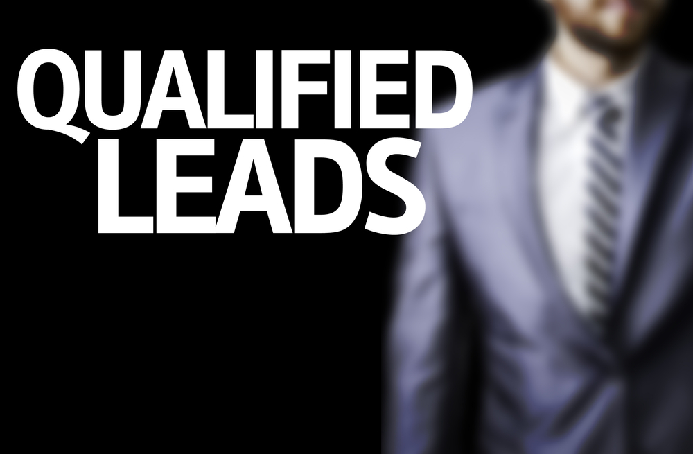 Business man with the text Qualified Leads in a concept image
