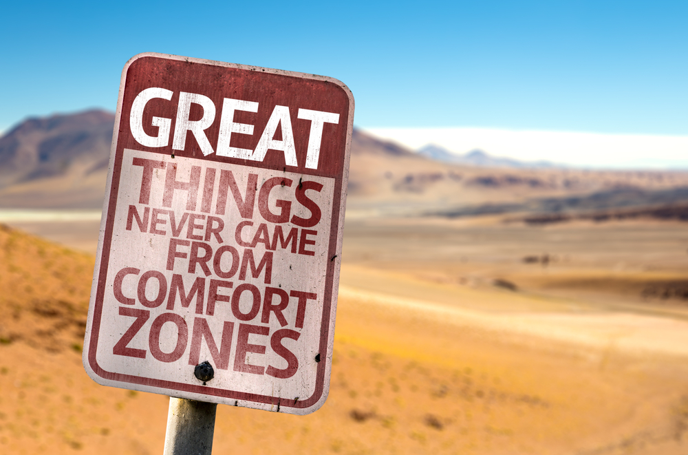Great Things Never Came From Comfort Zones sign with a desert background