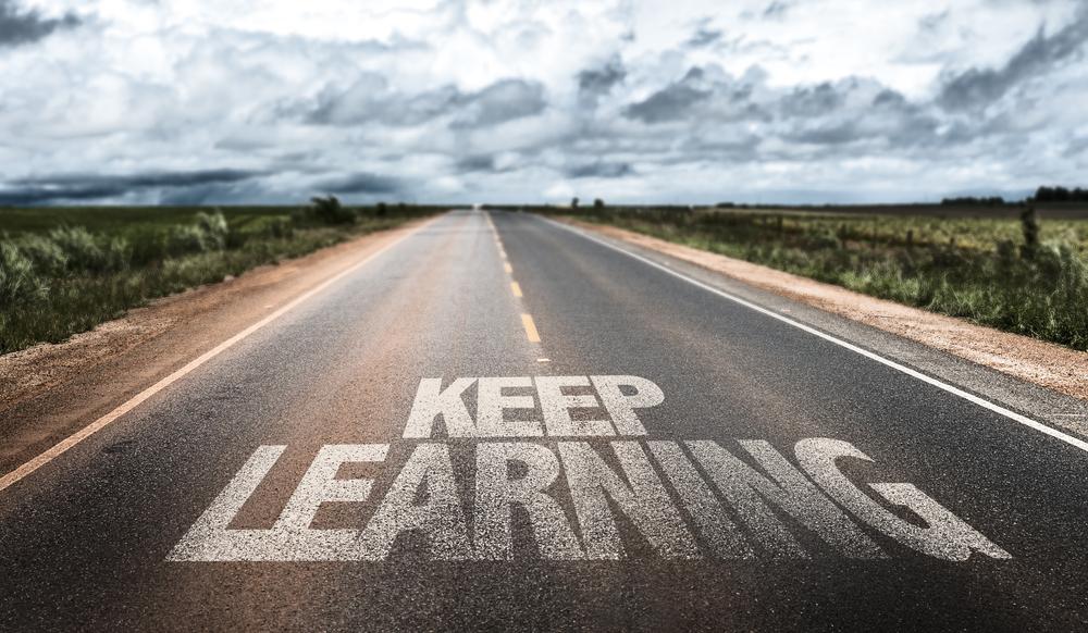 Keep Learning written on rural road-1