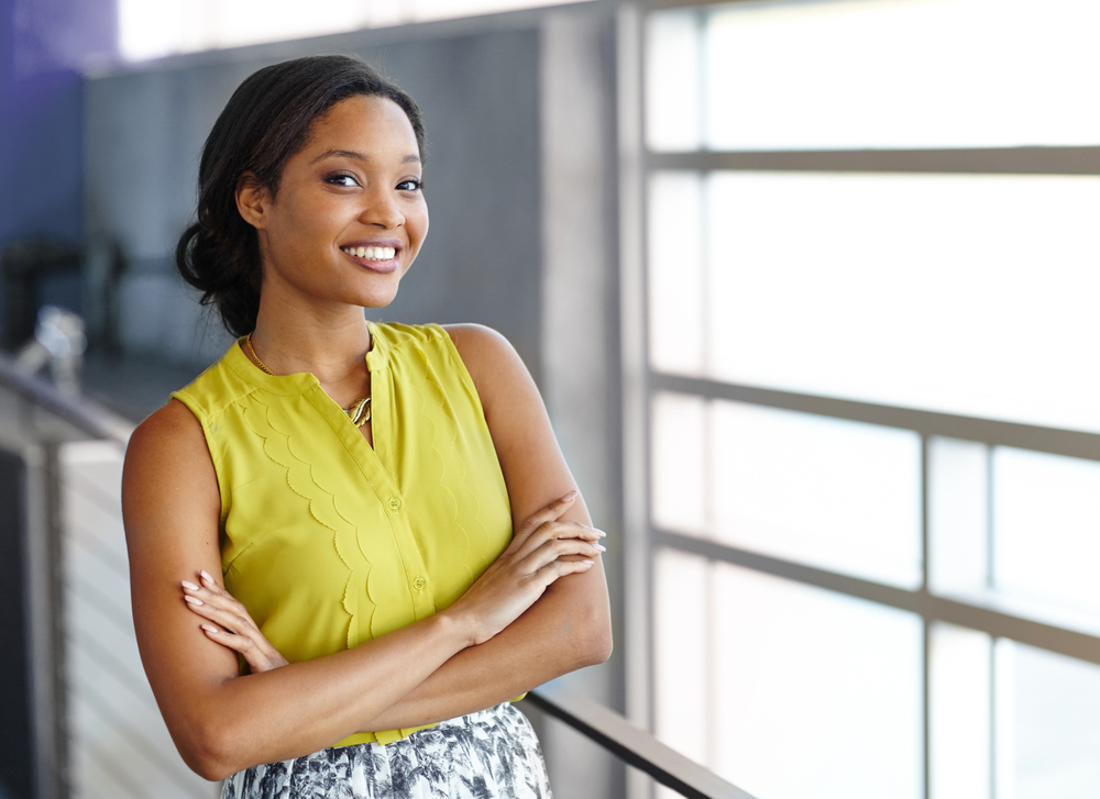 Portrait of a confident black businesswoman at work in her glass office-1