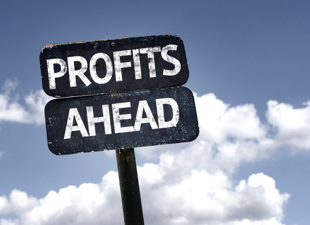 Profits Ahead sign with clouds and sky background