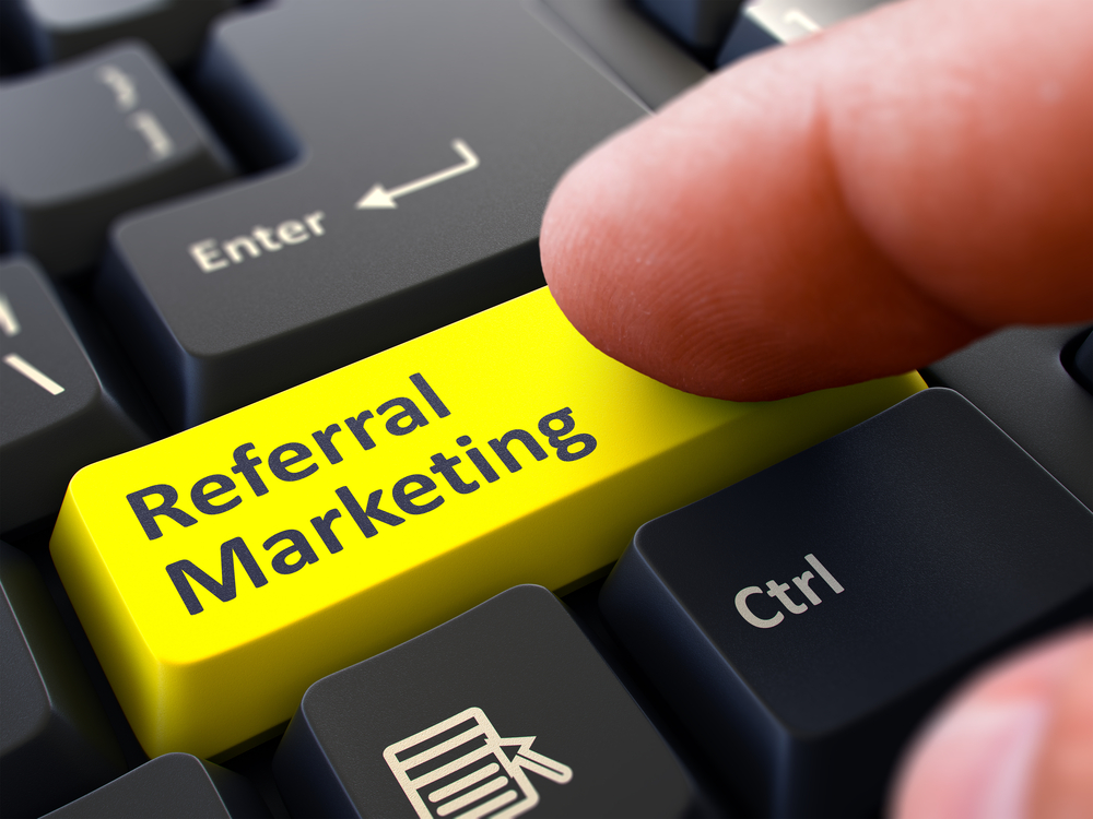 Referral Marketing Concept. Person Click on Yellow Keyboard Button. Selective Focus. Closeup View.