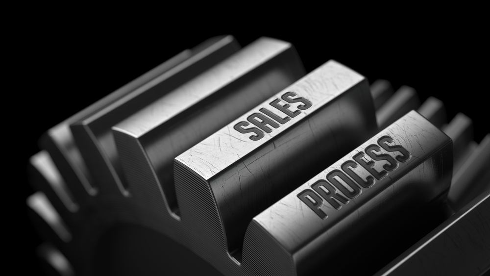 Sales Process on the Metal Gears on Black Background.-1