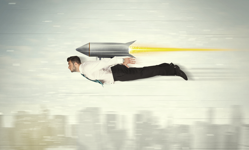 Superhero businessman flying with jet pack rocket above the city concept