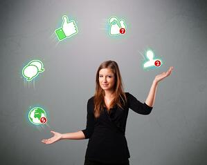 attractive young woman standing and juggling with social network icons