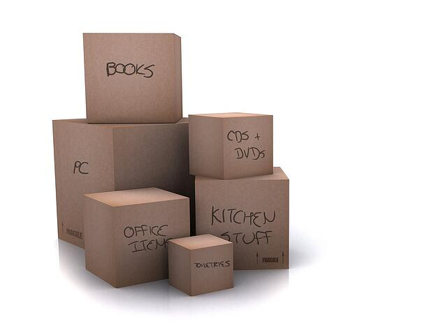 cardboard boxes - moving homes - over a white background - writing on boxes