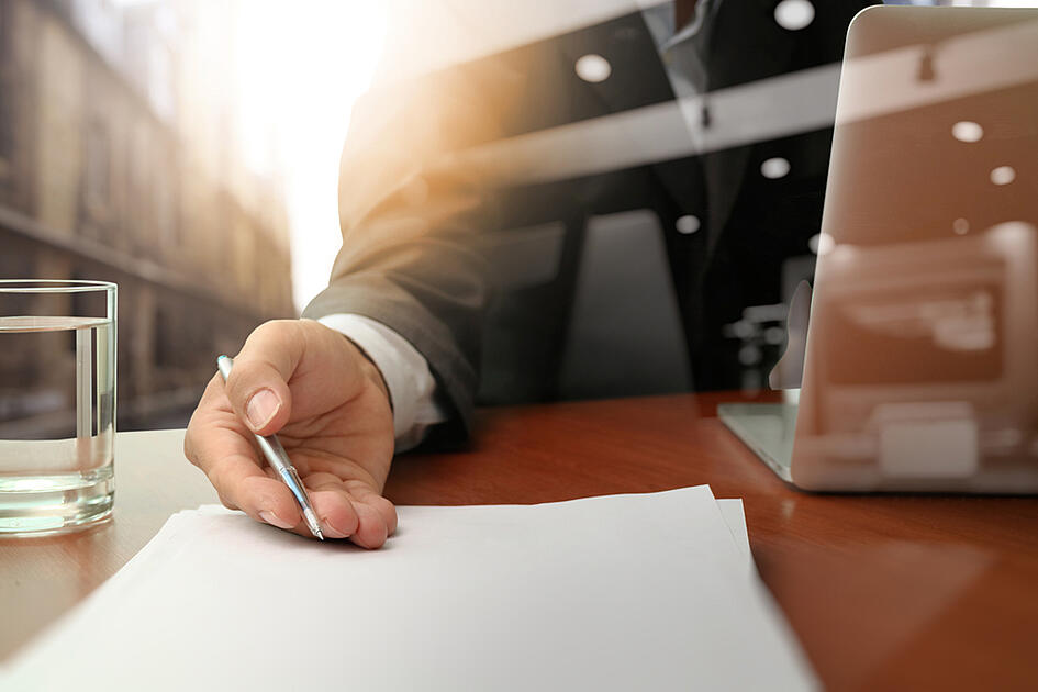 double exposure of businessman or salesman handing over a contract on wooden desk