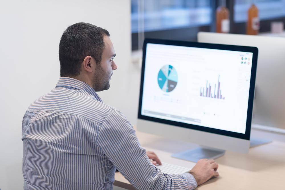 startup business, software developer working on desktop  computer at modern office