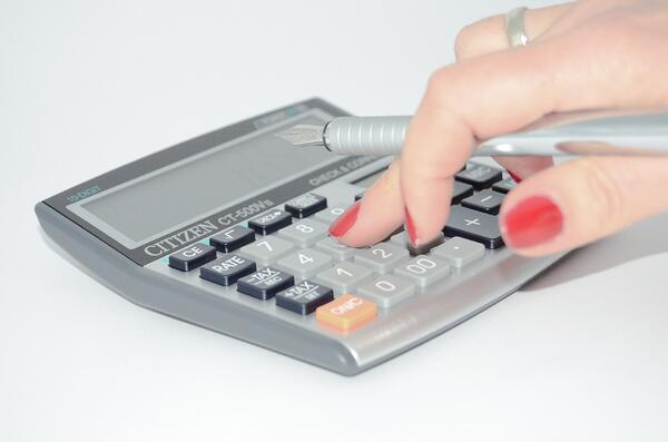 hand typing in calculator