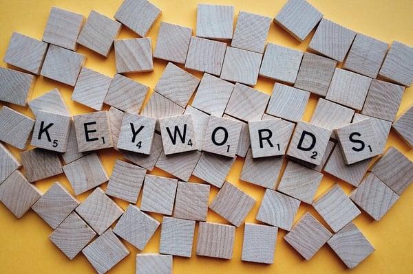 keywords spelled on wood tiles