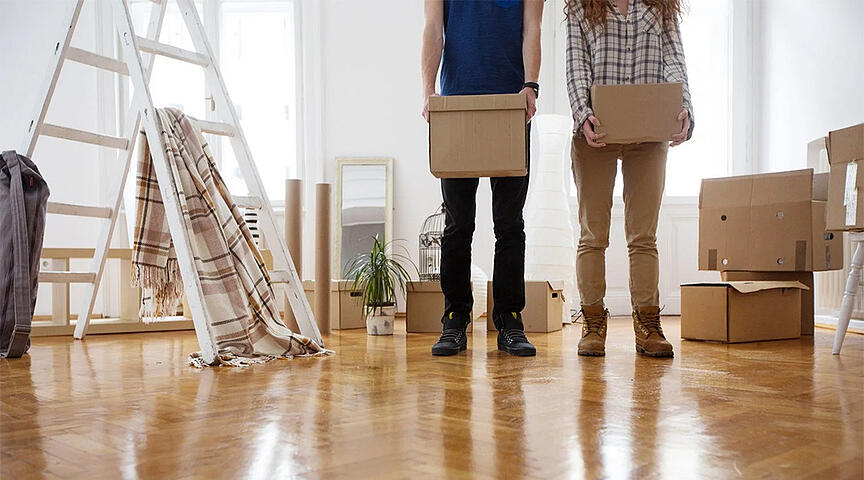 couple moving into their rental property and unpacking boxes