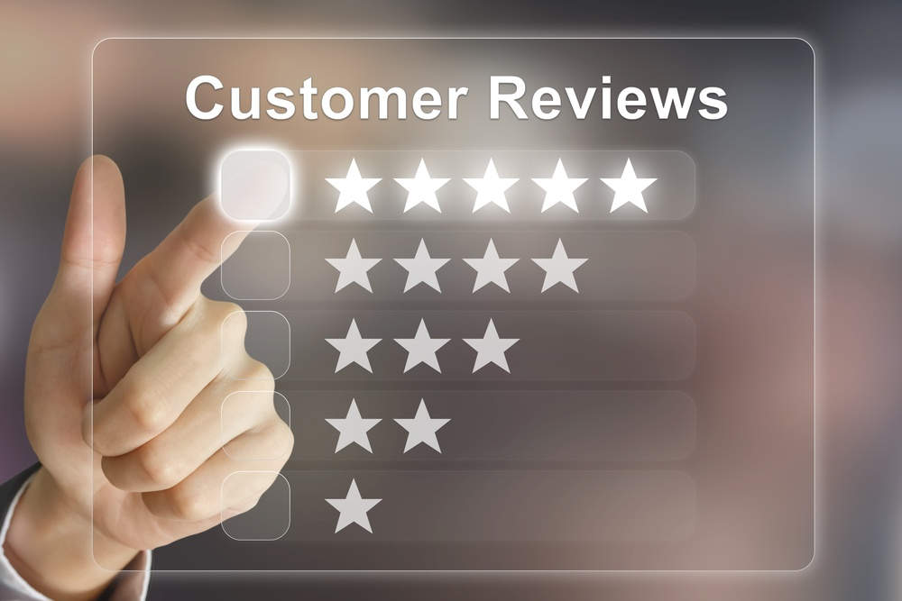 hand pointing to 5 star customer review on transparent screen board